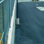 fresh asphalt is laid in the parking lot of a commercial facility